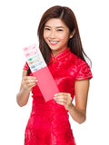Woman hold with red lucky money with RMB Royalty Free Stock Images
