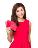 Woman hold with red pocket for lunar new year. Isolated over white background stock photo