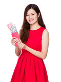 Woman hold red pocket money with RMB Stock Photos