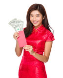 Woman hold red pocket money with USD Stock Image