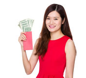 Woman hold red pocket with USD Royalty Free Stock Photography