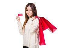 Woman hold with red shopping bag and credit card Stock Images