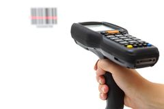Woman hold scanner and scans barcode with laser Royalty Free Stock Images