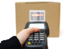 Woman hold scanner and scans barcode with laser Stock Photos