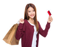 Woman hold shopping bag and credit card Stock Images