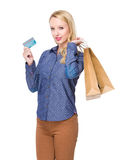 Woman hold shopping bag and credit card Stock Photos