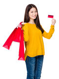 Woman hold with shopping bag and credit card Royalty Free Stock Images