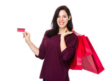 Woman hold shopping bag and credit card Stock Photo
