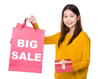 Woman hold shopping bag and gift box with showing big sale Royalty Free Stock Photo