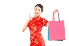 Woman hold shopping bag and thumb up Royalty Free Stock Photo