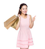 Woman hold shopping bag with thumb up Royalty Free Stock Images