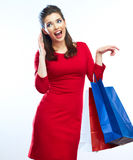 Woman hold shopping bags isolated on white background. Royalty Free Stock Image
