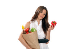 Woman hold shopping paper with vegetarian grocery Royalty Free Stock Photo