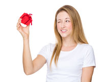 Woman hold with small gift and show with blink eye Royalty Free Stock Photo