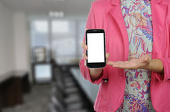 Woman hold smartphone in formal suit Royalty Free Stock Photos