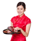 Woman hold snack tray for chinese new year Stock Photography