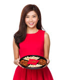 Woman hold with snack tray Stock Images