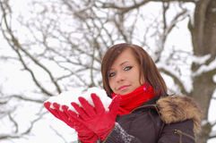 Woman hold snow. In her hands stock photos