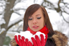 Woman hold snow. In her hands royalty free stock images