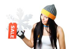 Woman hold snowflake with sale tag Stock Photo
