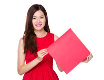 Woman hold with square of red banner Stock Photo