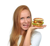Woman hold tasty unhealthy burger sandwich with cheese salad tom Royalty Free Stock Images