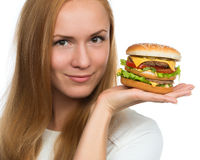 Woman hold tasty unhealthy burger sandwich in hands hungry Royalty Free Stock Images