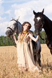The woman hold two horses Royalty Free Stock Photos