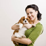 Woman hold up puppy Stock Image