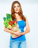 Woman hold vegetables in grocery bag Stock Photo