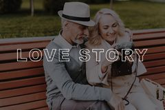 Woman Hold Vintage Camera . Old Couple Hugs . stock photos