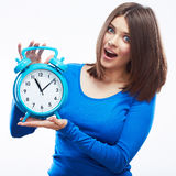 Woman hold watch on white background. Isolated female model. Royalty Free Stock Photos