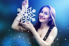 Woman hold white snowflake wearing in black dress Stock Photography