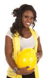 Woman hold yellow hard hat Royalty Free Stock Photos