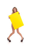 Woman hold yellow rectangle Stock Image