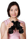 Woman holdign binoculars Royalty Free Stock Photo
