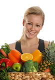 Woman holdind a basket of fruits Royalty Free Stock Photo