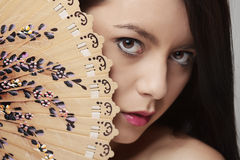 Woman holdind fan Royalty Free Stock Photos