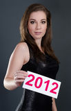 Woman holding a 2012 card Royalty Free Stock Photography