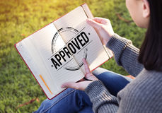 Woman Holding A Book Sitting On A Grass Stock Image