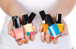 Woman Holding A Bottle Of Nail Polish Royalty Free Stock Photography