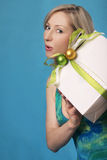 Woman Holding A Gift Stock Images