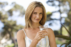 Free Woman Holding A Glass Of Water Royalty Free Stock Photos - 67227848