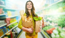 Woman Holding A Grocery Bag Stock Photos