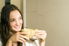 Woman Holding A Tea Cup Smiles - Horizontal Royalty Free Stock Photography