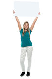Woman holding ad board above her head Royalty Free Stock Image