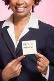 Woman holding an adhesive note Royalty Free Stock Photography