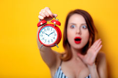 Woman holding aged red alarm clock royalty free stock photography