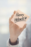 Woman holding agenda with Happy Halloween text Royalty Free Stock Photo
