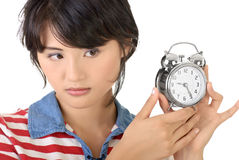 Woman holding alarm clock Royalty Free Stock Photography